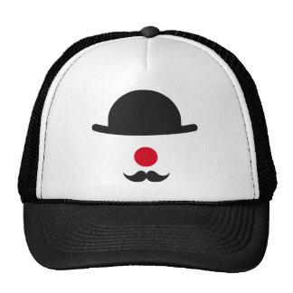cara del payaso con el gorra, la nariz roja y el b gorras