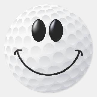 Cara del smiley de la pelota de golf pegatina redonda