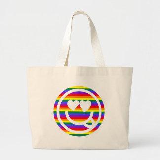 Cara del smiley del arco iris bolsas