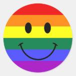 Cara del smiley del arco iris etiqueta redonda