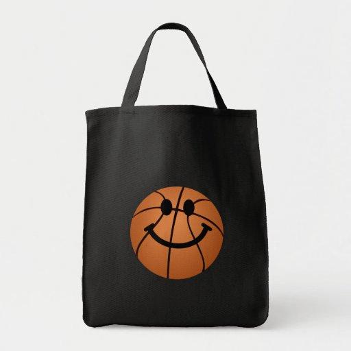 Cara del smiley del baloncesto bolsas de mano