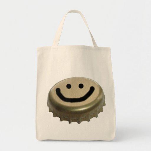 Cara del smiley del casquillo de la botella de bolsa