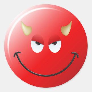 Cara del smiley del diablo pegatina redonda