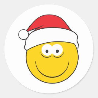 Cara del smiley del gorra de Santa Pegatina Redonda