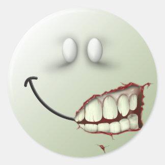 Cara del smiley del zombi pegatina redonda
