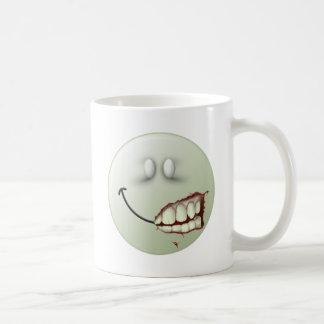 Cara del smiley del zombi tazas de café