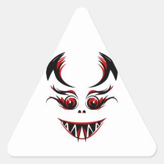 Cara del vampiro/del monstruo/del demonio con los pegatina triangular