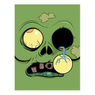 Cara del zombi con el ojo haciendo estallar hacia tarjeta postal