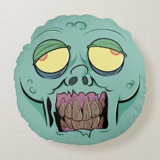 Cara del zombi con una mueca dentuda cojín redondo