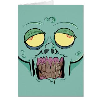 Cara del zombi con una mueca dentuda tarjeta de felicitación