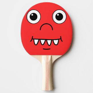Cara divertida del dibujo animado pala de tenis de mesa
