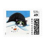 Cara en la nieve - franqueo del gato del navidad