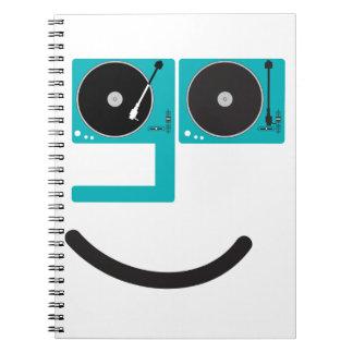 Cara feliz de la placa giratoria libreta espiral