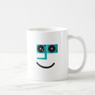 Cara feliz de la placa giratoria tazas