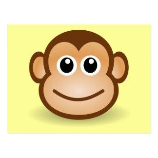 Cara feliz del mono del dibujo animado lindo tarjeta postal