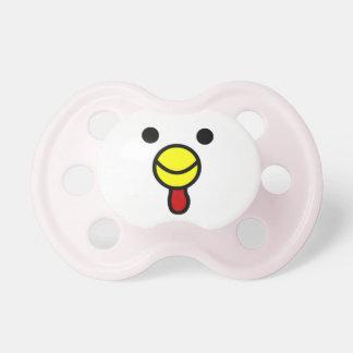 Cara feliz linda del pollo chupetes de bebé