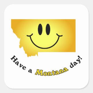¡Cara feliz - tenga un día de Montana! Calcomanía Cuadradase