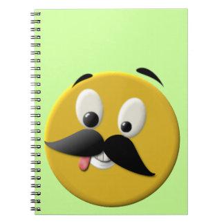 Cara feliz torpe con el bigote libro de apuntes
