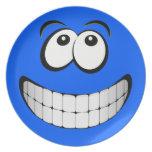 Cara grande azul del smiley de la mueca platos de comidas