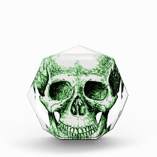 Cara humana verde del cráneo