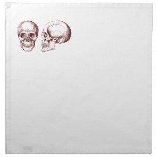 Cara lateral de los cráneos humanos rojos servilleta