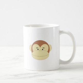 Cara linda del mono del dibujo animado tazas