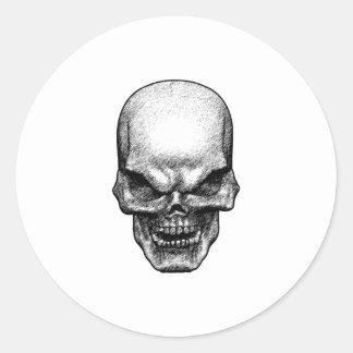 Cara malvada del cráneo pegatina redonda