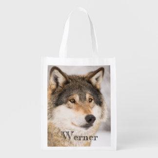 Cara personalizada del lobo en un bosque del bolsas de la compra