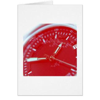 Cara roja del reloj del suizo tarjeta de felicitación