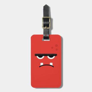 Cara roja divertida del monstruo etiquetas maleta