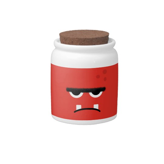 Cara roja divertida del monstruo jarra para caramelo