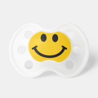 Cara sonriente amarilla chupetes