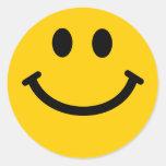 Cara sonriente amarilla etiqueta redonda