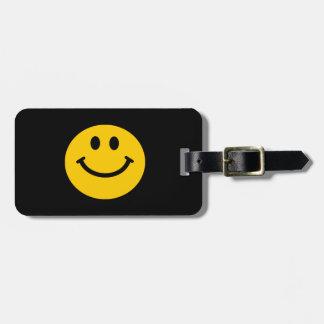 Cara sonriente amarilla etiquetas para maletas