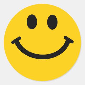 Cara sonriente amarilla pegatina redonda