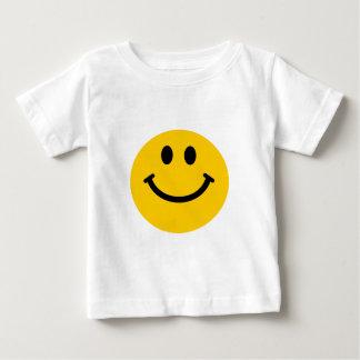 Cara sonriente amarilla playera de bebé