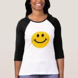 Cara sonriente amarilla remera