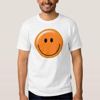 Cara sonriente anaranjada feliz playeras