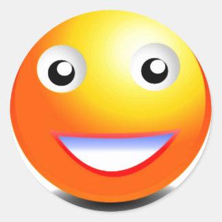 Cara sonriente anaranjada y amarilla pegatinas redondas