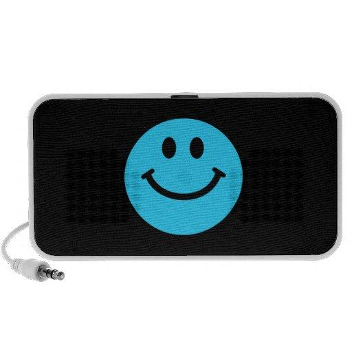 Cara sonriente azul laptop altavoces