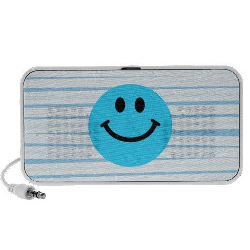 Cara sonriente azul en rayas portátil altavoz