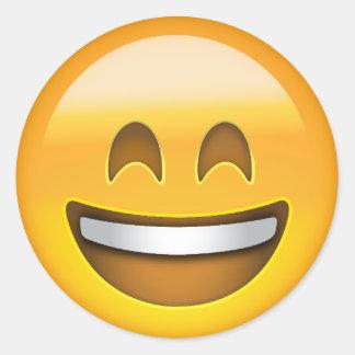 Cara sonriente con la boca abierta y ojos pegatina redonda