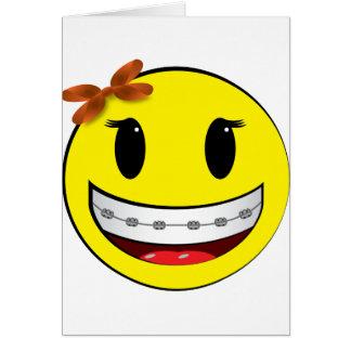 Cara sonriente con los apoyos - chica felicitación