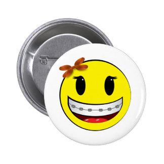 Cara sonriente con los apoyos - chica pins