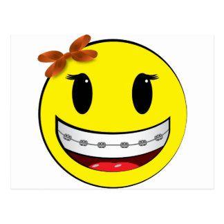Cara sonriente con los apoyos - chica postal