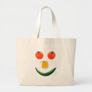 Cara sonriente de la ensalada bolsas de mano