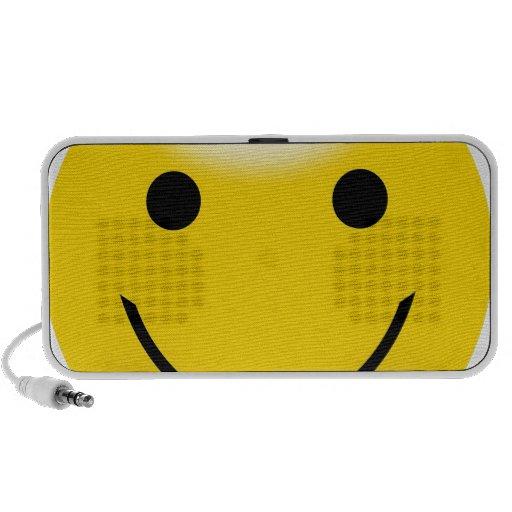 Cara sonriente de la felicidad portátil altavoz