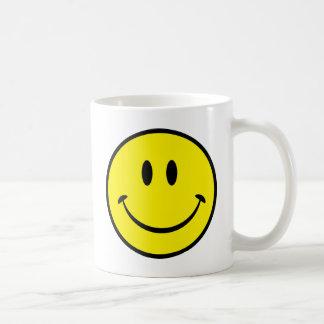 Cara sonriente de la felicidad taza