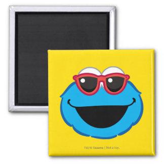 Cara sonriente de la galleta con las gafas de sol imán cuadrado