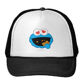 Cara sonriente de la galleta con los ojos en forma gorras de camionero